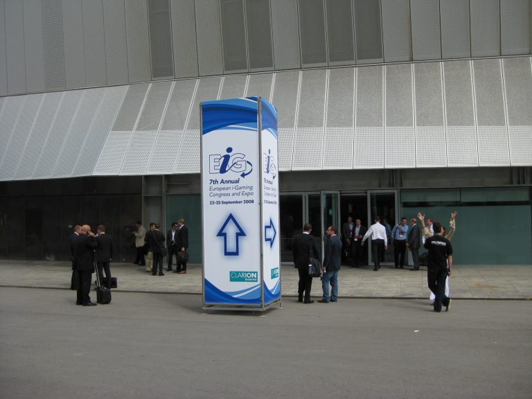 2 freestanding tower at CCIB made of iron poles with printed PVC banners